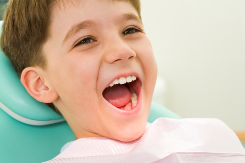 Young boy happy at the dentist